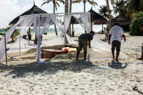 Staff preparing for a beach dinner